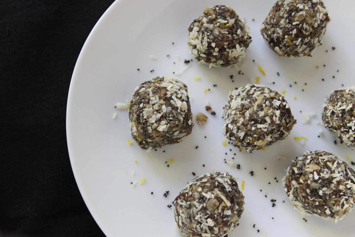 Vegan Lemon Coconut Energy Balls on a white plate.