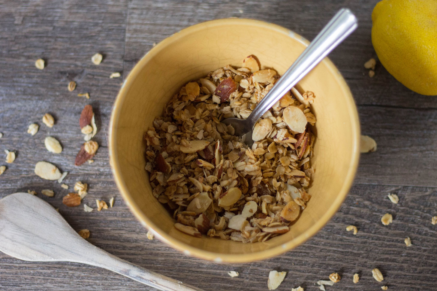 Vegan granola in yellow bowl.