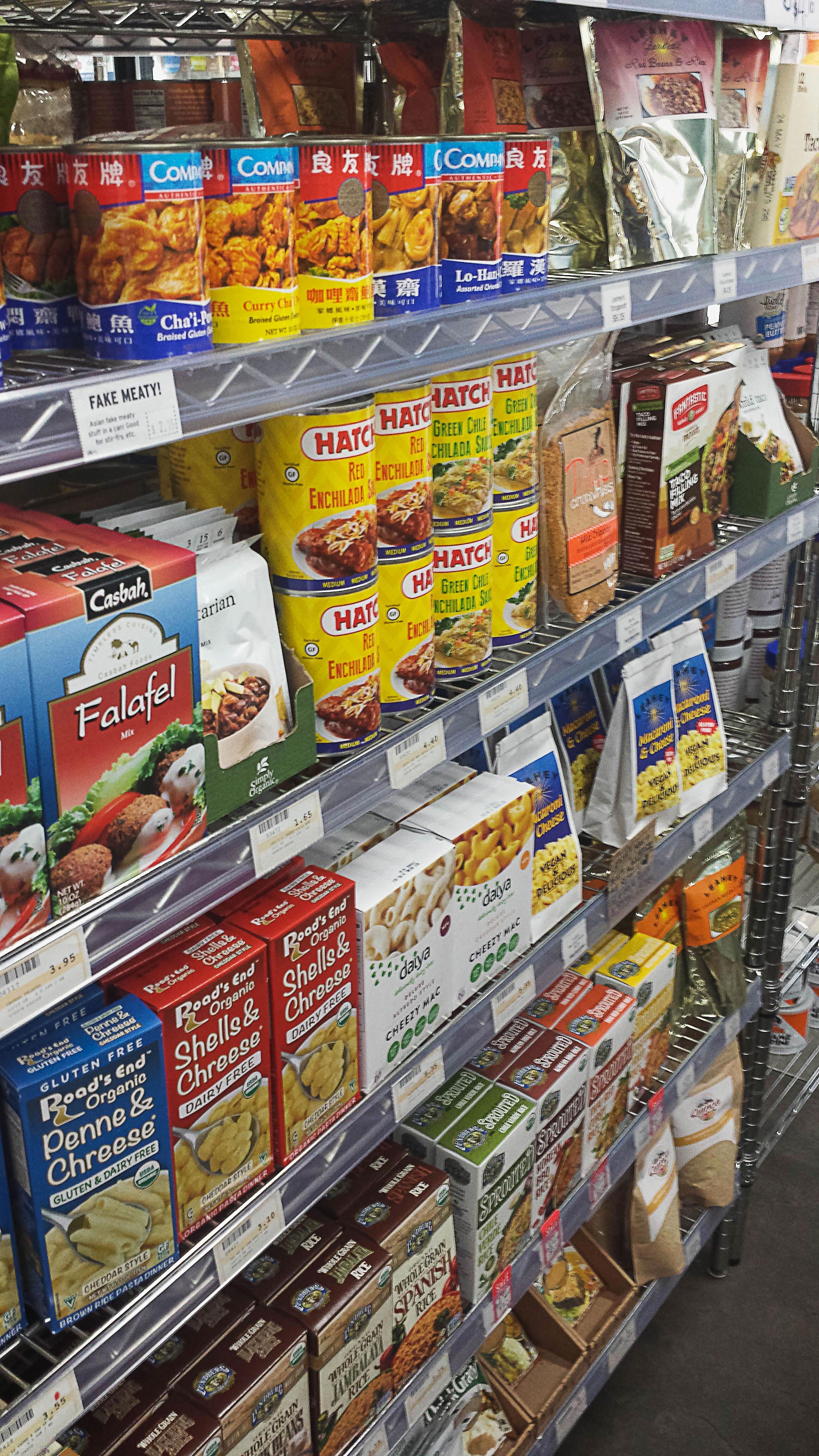Vegan food on a shelf inside of Food Fight grocery store.