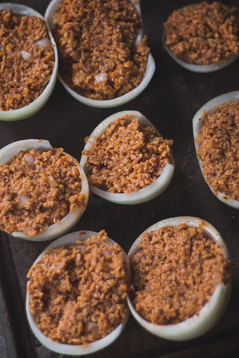 Onion halves filled with vegan sloppy joe mix.
