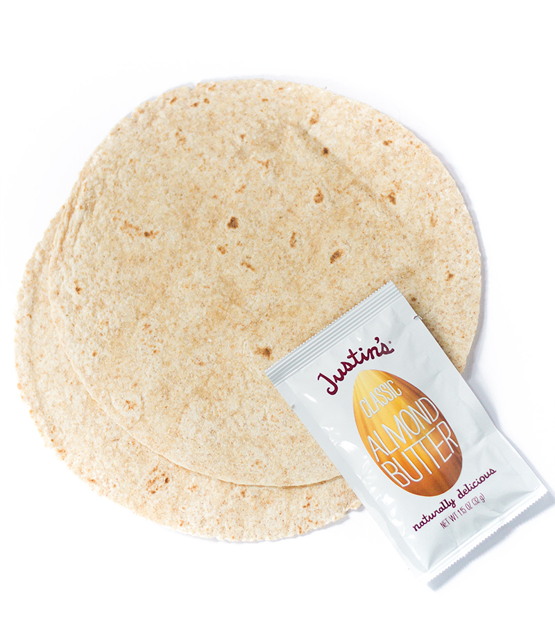 Two tortillas and a packet of Justin's almond butter