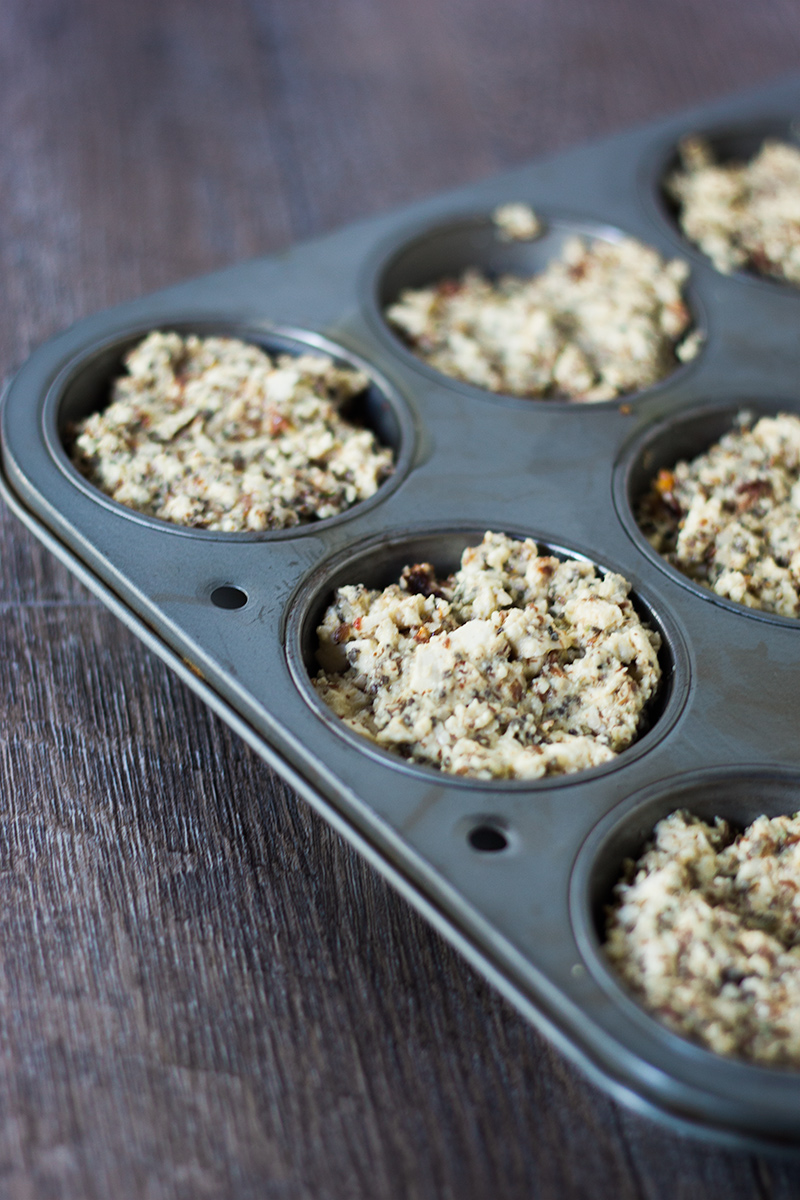 Unbaked vegan quiche mixture in a muffin pan.