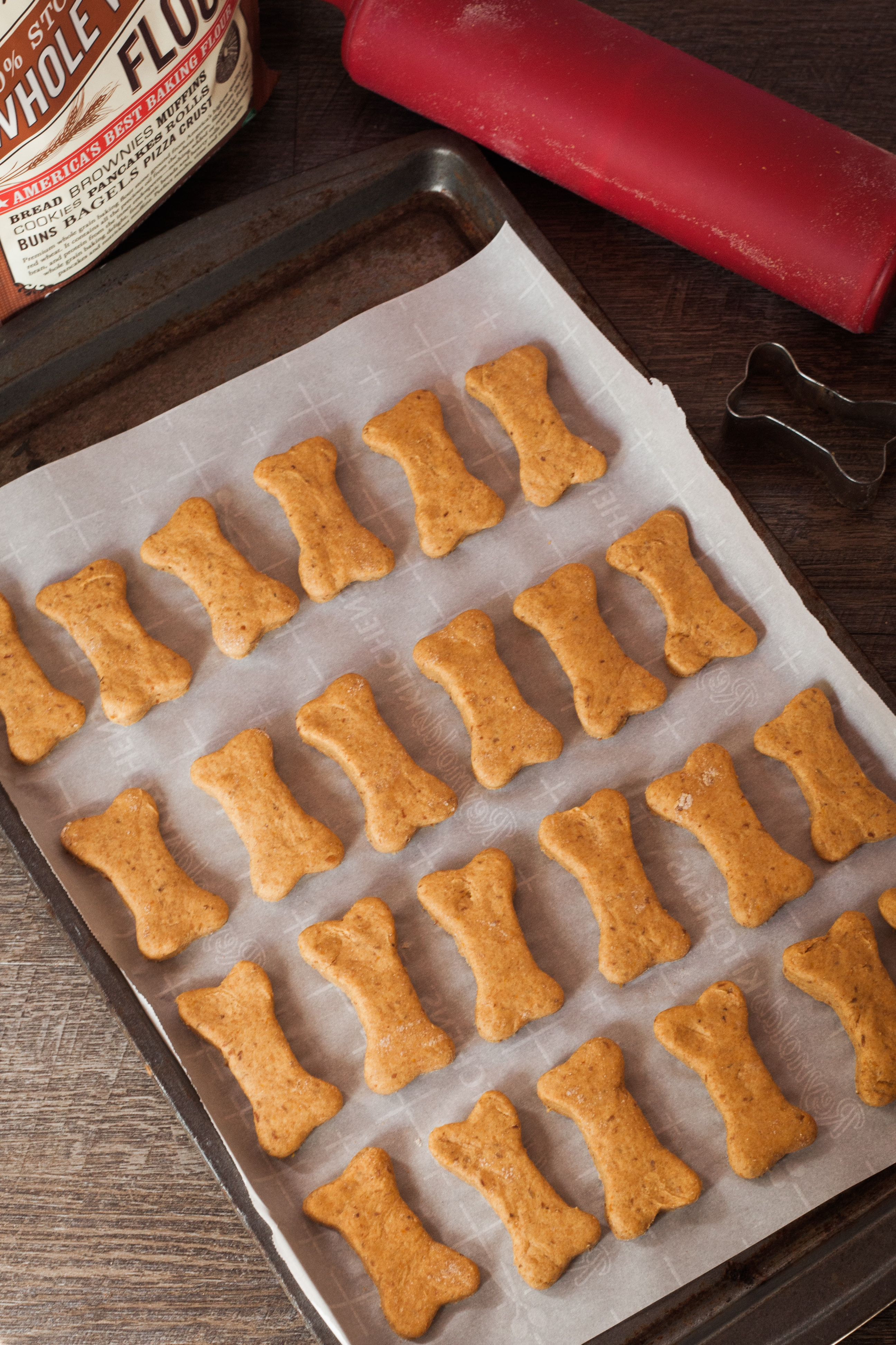Dog treats on a baking sheet.