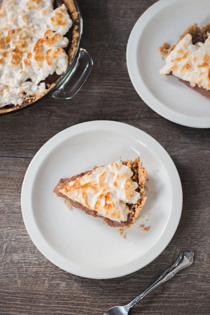 Vegan s'mores pie on white plates.