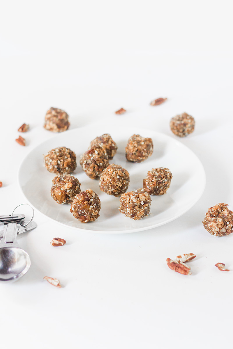 Vegan apple pie bites and pecans on a white background.