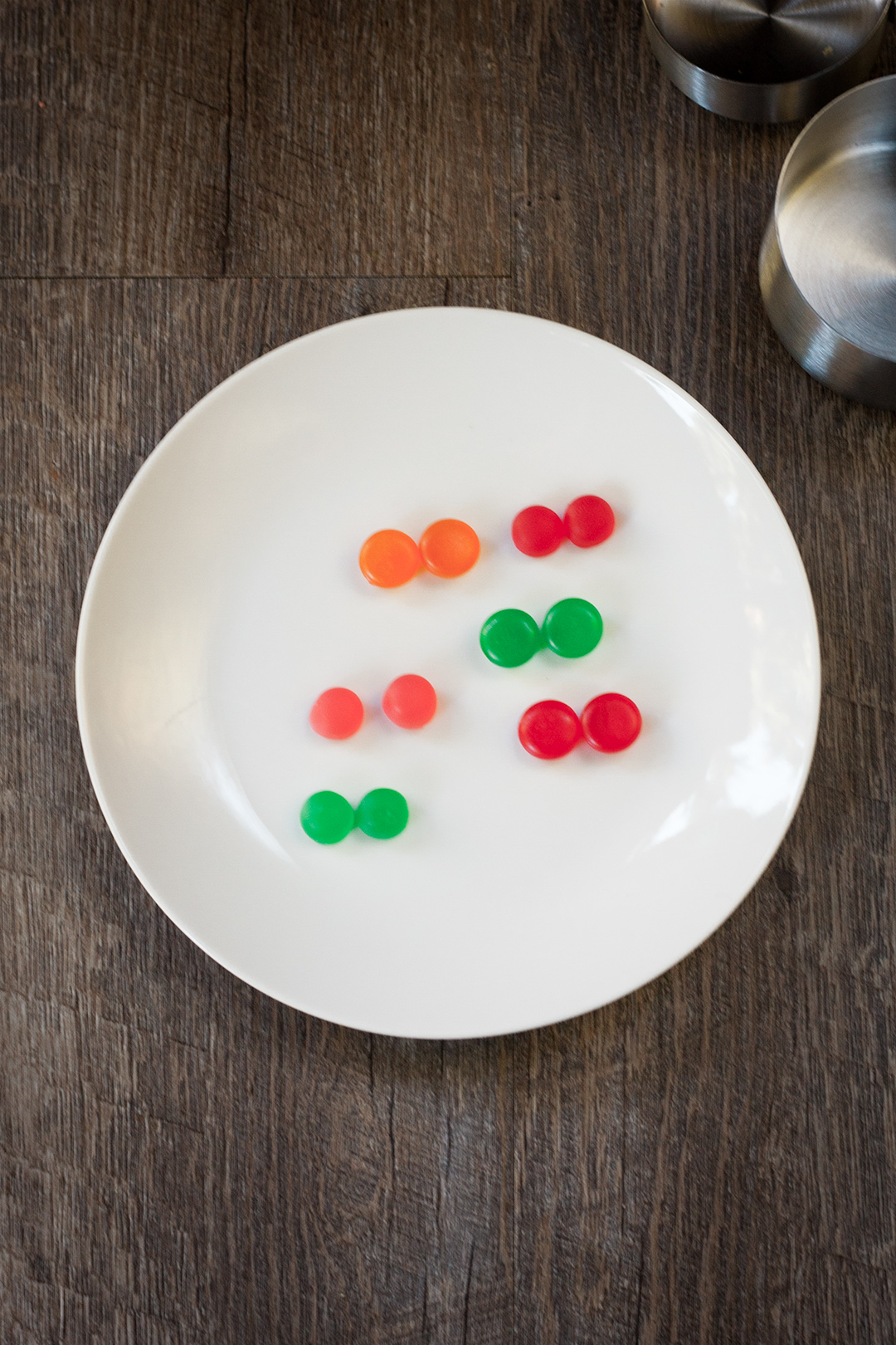 Dots cut in half on a white plate.