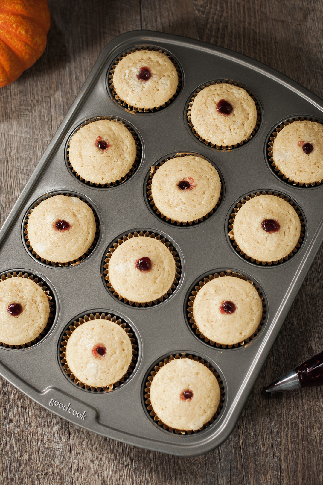 A whole batch of vegan cupcakes with filling.